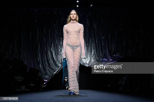 A model walks the runway during the Marco Rambaldi fashion show as part of Milan Fashion Week Fall/Winter 20202021 on February 19 2020 in Milan Italy