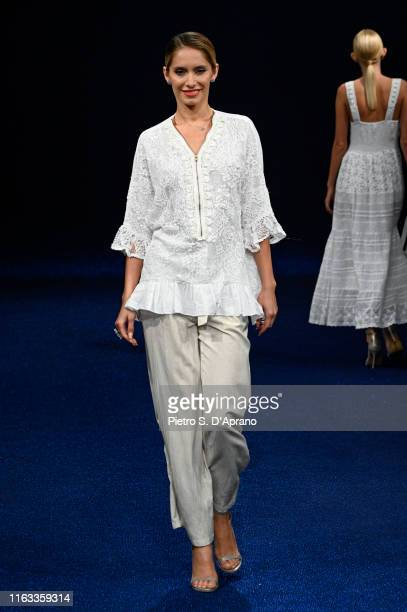A model walks the runway during the Maredamare 2019 David Iconique Summer fashion show at Fortezza Da Basso on July 21 2019 in Florence Italy