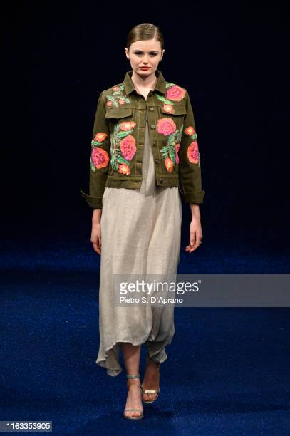Model walks the runway during the Maredamare 2019 - Iconique Summer fashion show at Fortezza Da Basso on July 21, 2019 in Florence, Italy.