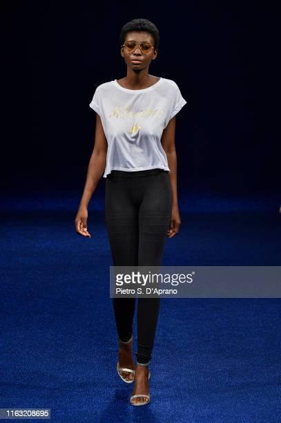 A model walks the runway during the Maredamare 2019 Milano#41 Ubk Company Co Fashion Show fashion show at Fortezza Da Basso on July 20 2019 in...