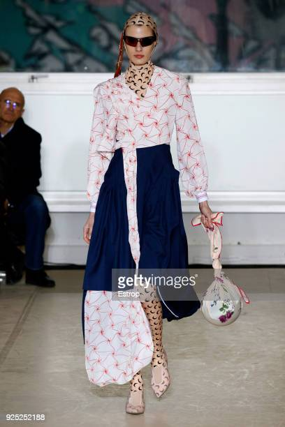 A model walks the runway during the Marine Serre show as part of the Paris Fashion Week Womenswear Fall/Winter 2018/2019 on February 27 2018 in Paris...
