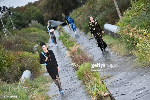 Model walks the runway during the Marine Serre Womenswear Spring/Summer 2020 fashion show as part of Paris Fashion Week on September 24, 2019 in...
