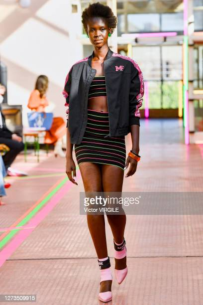 A model walks the runway during the Mark Fast Ready to Wear Spring/Summer 2021 fashion show during LFW September 2020 at Hackney Depot on September...