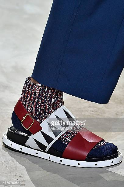 A model walks the runway during the Marni Ready to Wear fashion show as part of Milan Men's Fashion Week Spring/Summer 2016 on June 20 2015 in Milan...