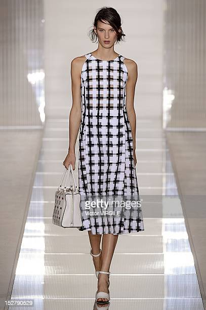 Model walks the runway during the Marni show as a part of Milan Fashion Week Womenswear S/S 2013 on September 23, 2012 in Milan, Italy.