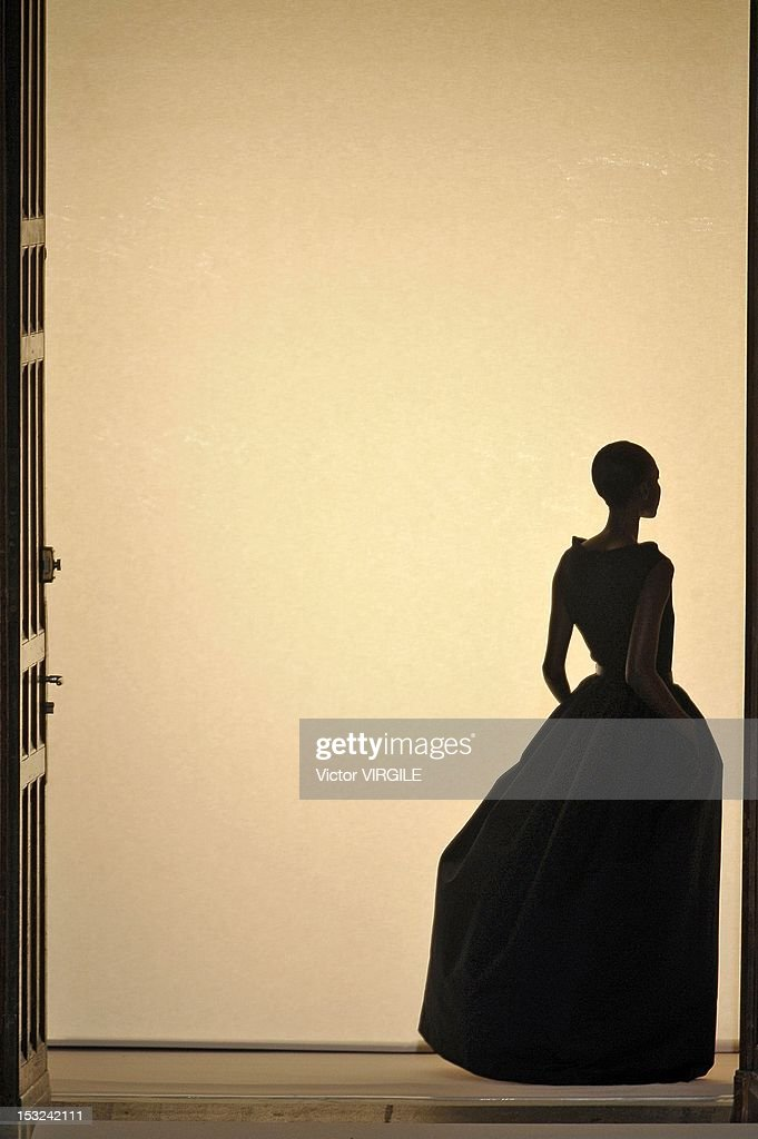 A model walks the runway during the Martin Grant Spring / Summer Womenswear 2013 show as part of Paris Fashion Week at Les Beaux-Arts de Paris on September 29, 2012 in Paris, France.