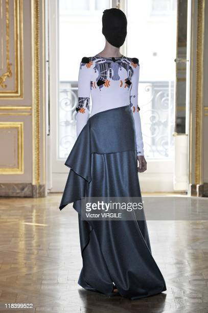 A model walks the runway during the Martin Margiela Haute Couture Fall/Winter 20112012 show as part of the Paris Haute Couture Fashion Week on July...