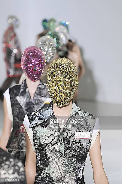 A model walks the runway during the Martin Margiela Haute Couture Fall Winter 20122013 show as part of the Paris Haute couture Week on July 4 2012 in...