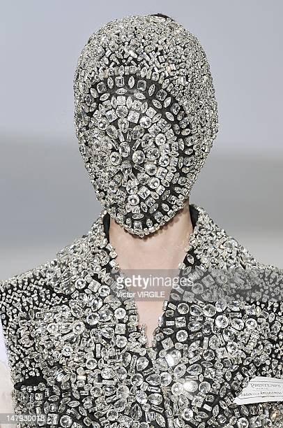 Model walks the runway during the Martin Margiela Haute Couture Fall Winter 2012-2013 show as part of the Paris Haute couture Week on July 4, 2012 in...