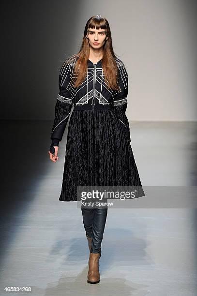 A model walks the runway during the Masha Ma show as part of Paris Fashion Week Womenswear Fall/Winter 2015/2016 at Palais de Tokyo on March 11 2015...
