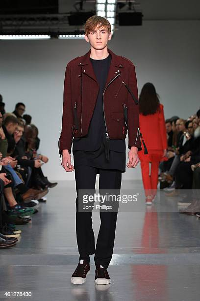 A model walks the runway during the Matthew Miller show at the London Collections Men AW15 at Victoria House on January 10 2015 in London England
