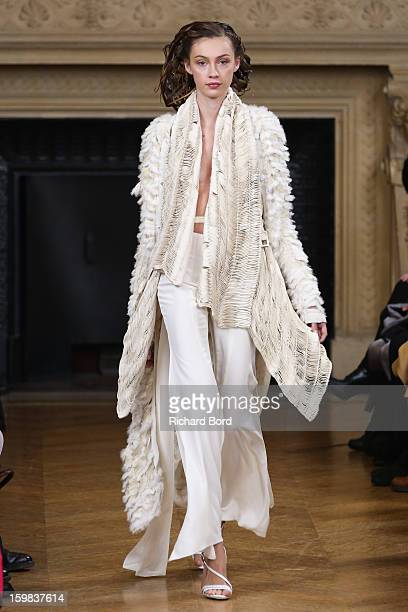 A model walks the runway during the Maurizio Galante Spring/Summer 2013 HauteCouture show as part of Paris Fashion Week at Theatre du Chatelet on...