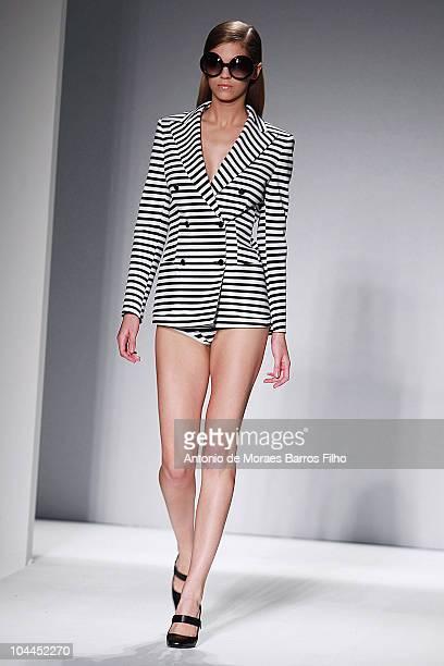 Model walks the runway during the Max Mara Milan Fashion Week Womenswear S/S 2011 show on September 25, 2010 in Milan, Italy.