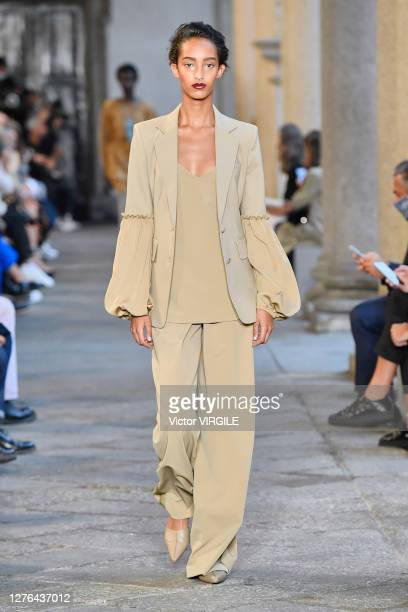 Model walks the runway during the Max Mara Ready to Wear Spring/Summer 2021 fashion show during Milan Women's Fashion Week Spring/Summer 2021 on...