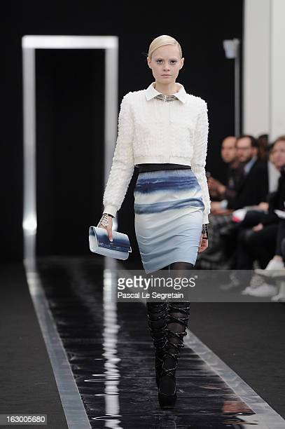 Model walks the runway during the Maxime Simoens Fall/Winter 2013 Ready-to-Wear show as part of Paris Fashion Week on March 3, 2013 in Paris, France.