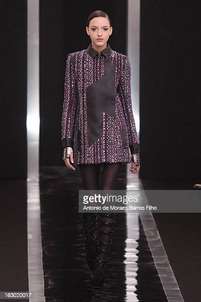 A model walks the runway during the Maxime Simoens Fall/Winter 2013 ReadytoWear show as part of Paris Fashion Week on March 3 2013 in Paris France