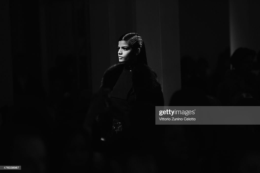 A model walks the runway during the Maxime Simoens show as part of the Paris Fashion Week Womenswear Fall/Winter 2014-2015 at Lycee Jean Zay on March 2, 2014 in Paris, France.
