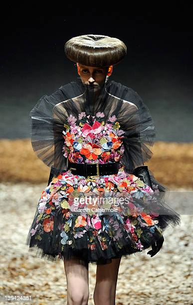 A model walks the runway during the McQ Alexander McQueen show at London Fashion Week Autumn/Winter 2012 on February 20 2012 in London England