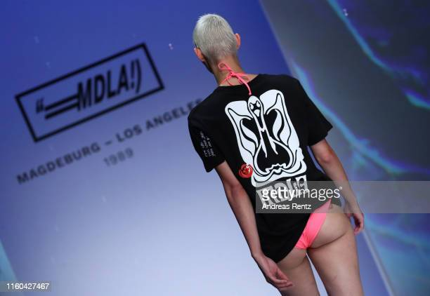 Model walks the runway during the MDLA by Bill Kaulitz fashion show during the AYFW - About You Fashion Week at ewerk on July 06, 2019 in Berlin,...