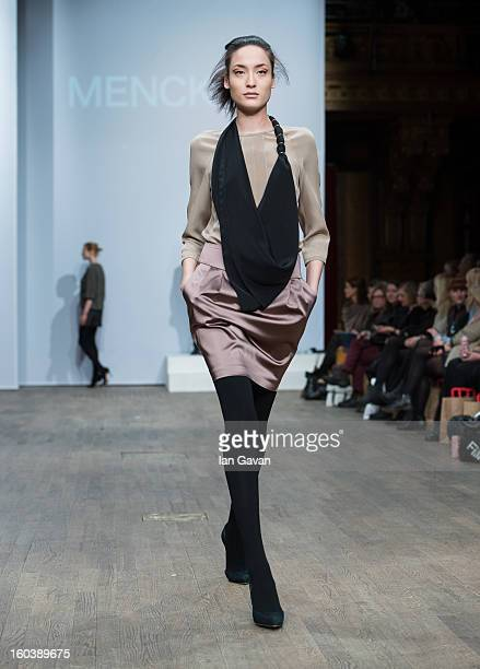 A model walks the runway during the Menckel show at MercedesBenz Stockholm Fashion Week Autumn/Winter 2013 at Berns on January 30 2013 in Stockholm...