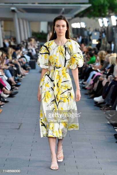 A model walks the runway during the MercedesBenz Presents Aje show at MercedesBenz Fashion Week Resort 20 Collections at Campbell's Stores on May 12...