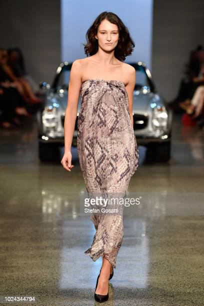 A model walks the runway during the MercedesBenz Presents Knuefermann show during New Zealand Fashion Week 2018 at Viaduct Events Centre on August 27...