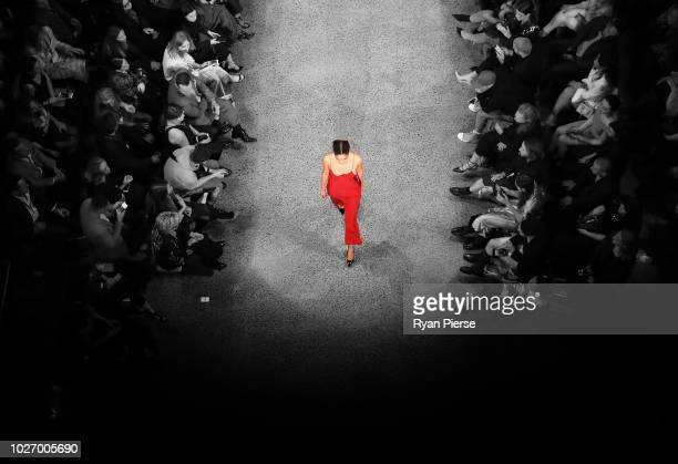 Image was altered with digital filters.) A model walks the runway during the Mercedes-Benz Presents Knuefermann show during New Zealand Fashion Week...