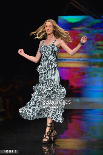 Model walks the runway during the Miami Fashion Week Jaqueline Then Fashion Show at Ice Palace Film Studios on June 02, 2019 in Miami, Florida.