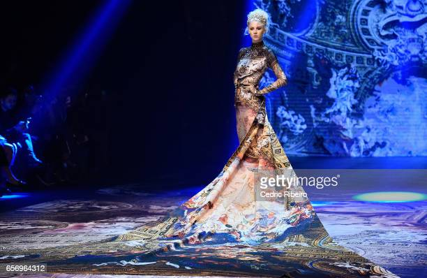 A model walks the runway during the Michael Cinco show at Fashion Forward March 2017 held at the Dubai Design District on March 23 2017 in Dubai...