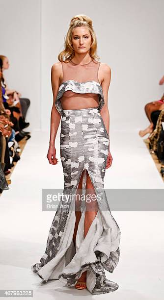 A model walks the runway during the Michael Costello fashion show during MercedesBenz Fashion Week Fall 2014 at Helen Mills Event Space on February 8...