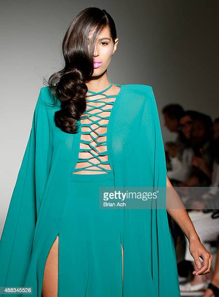 A model walks the runway during the Michael Costello Spring 2016 show during New York Fashion Week at Pier 59 on September 15 2015 in New York City