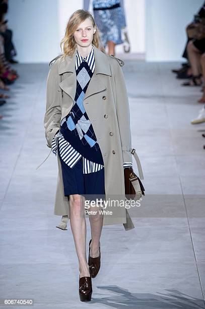 A model walks the runway during the Michael Kors fashion show at Spring Studios on September 14 2016 in New York City