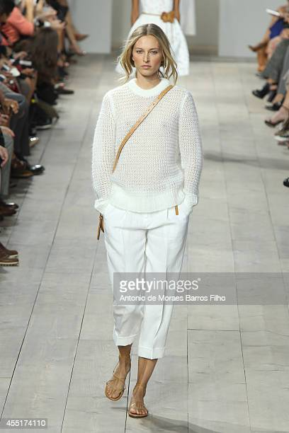 A model walks the runway during the Michael Kors show at MercedesBenz Fashion Week Spring 2015 at Spring Studios on September 10 2014 in New York City