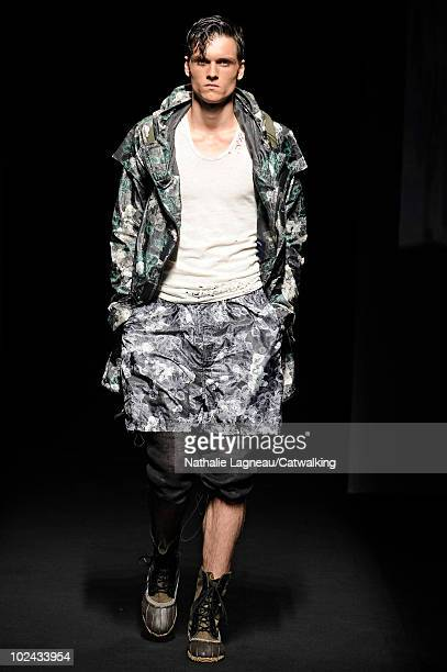 A model walks the runway during the Miharayasuhiro fashion show at Paris Menswear Fashion Week for Spring Summer 2011 on June 26 2010 in Paris France
