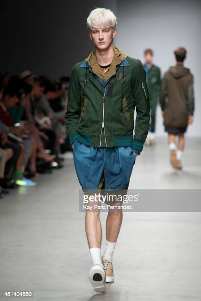 Model walks the runway during the Miharayasuhiro show as part of the Paris Fashion Week Menswear Spring/Summer 2015 on June 28, 2014 in Paris, France.