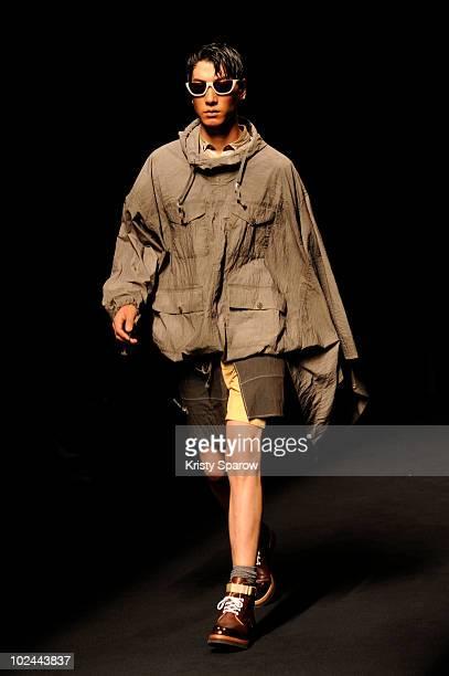A model walks the runway during the Miharayasuhiro showas part of Paris Menswear Fashion Week Spring/Summer 2011 at Le Carrousel du Louvre on June 26...