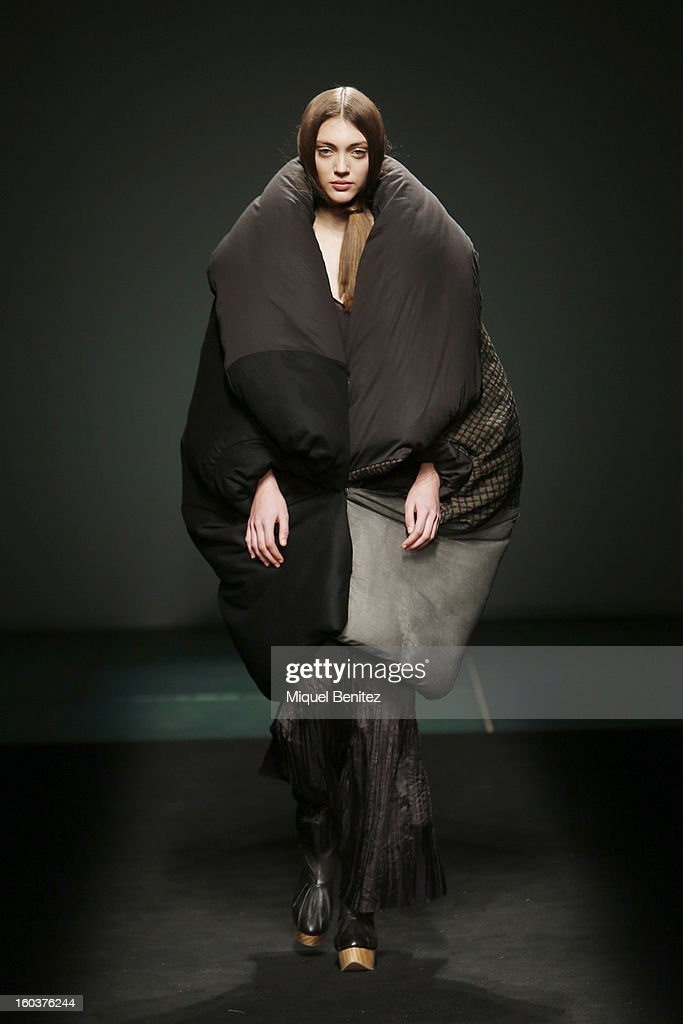 A model walks the runway during the Miriam Ponsa fashion show as part of the 080 Barcelona Fashion Week Autumn/Winter 2013-2014 on January 30, 2013 in Barcelona, Spain.