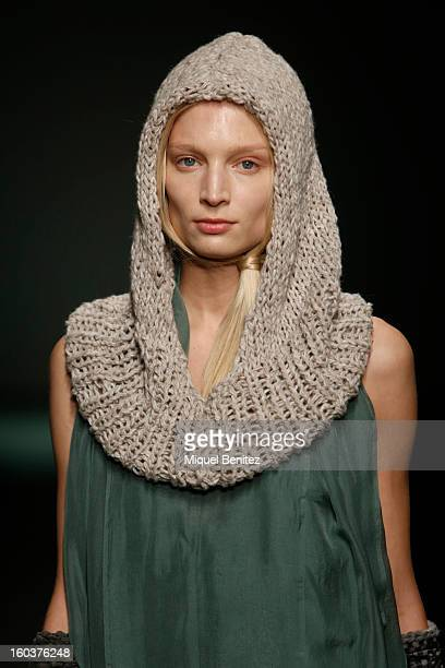 A model walks the runway during the Miriam Ponsa fashion show as part of the 080 Barcelona Fashion Week Autumn/Winter 20132014 on January 30 2013 in...