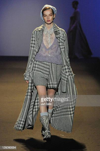 A model walks the runway during the Missoni show as part of Step With Fashion Charity Fashion event for 2011 Tohoku earthquake and tsunami at Tokyo...