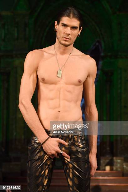A model walks the runway during the MisterTripleX presentation during New York Fashion Week Powered by Art Hearts Fashion NYFW at The Angel Orensanz...