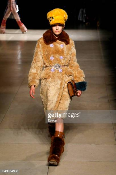 A model walks the runway during the Miu Miu designer Miuccia Prada show as part of the Paris Fashion Week Womenswear Fall/Winter 2017/2018 on March 7...