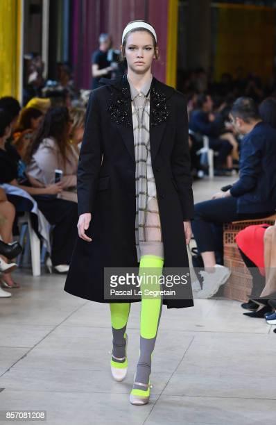 A model walks the runway during the Miu Miu Paris show as part of the Paris Fashion Week Womenswear Spring/Summer 2018 on October 3 2017 in Paris...