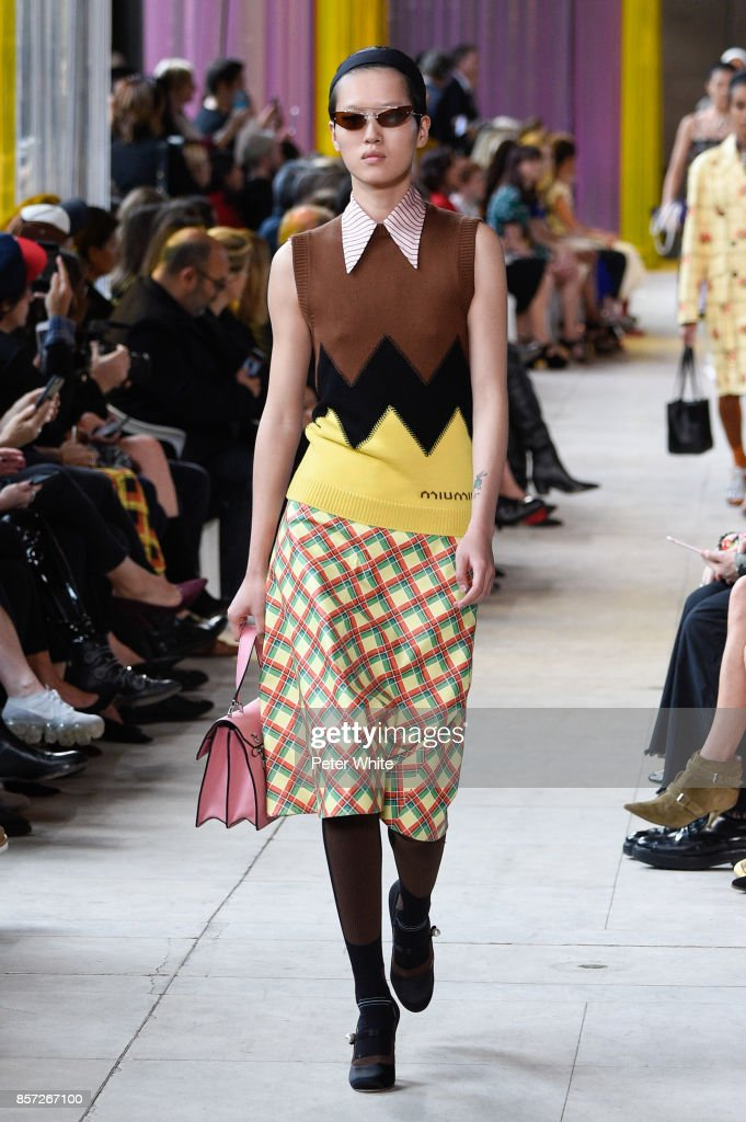 A model walks the runway during the Miu Miu Paris show as part of the Paris Fashion Week Womenswear Spring/Summer 2018 on October 3, 2017 in Paris, France.