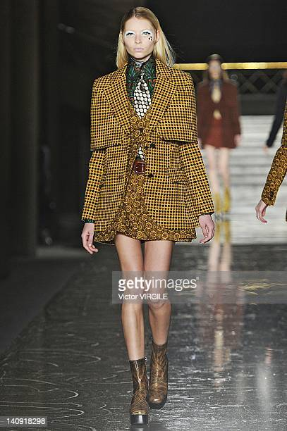 Model walks the runway during the Miu Miu Ready to Wear Fall/Winter 2011 show as part of the Paris Fashion Week on March 07, 2012 in Paris, France.