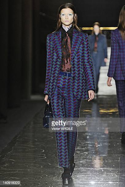 A model walks the runway during the Miu Miu Ready to Wear Fall/Winter 2011 show as part of the Paris Fashion Week on March 07 2012 in Paris France
