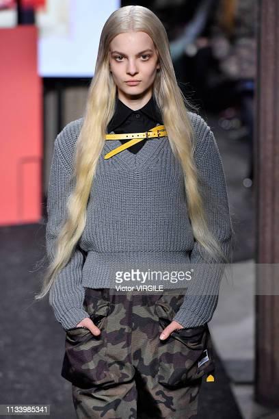 A model walks the runway during the Miu Miu Ready to Wear fashion show as part of the Paris Fashion Week Womenswear Fall/Winter 2019/2020 on March 05...