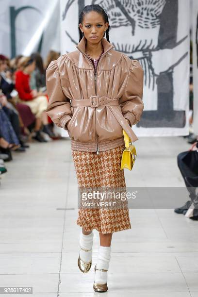 A model walks the runway during the Miu Miu Ready to Wear fashion show as part of the Paris Fashion Week Womenswear Fall/Winter 2018/2019 on March 6...