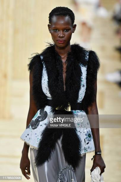 A model walks the runway during the Miu Miu Ready to Wear Spring/Summer 2020 fashion show as part of Paris Fashion Week on October 01 2019 in Paris...