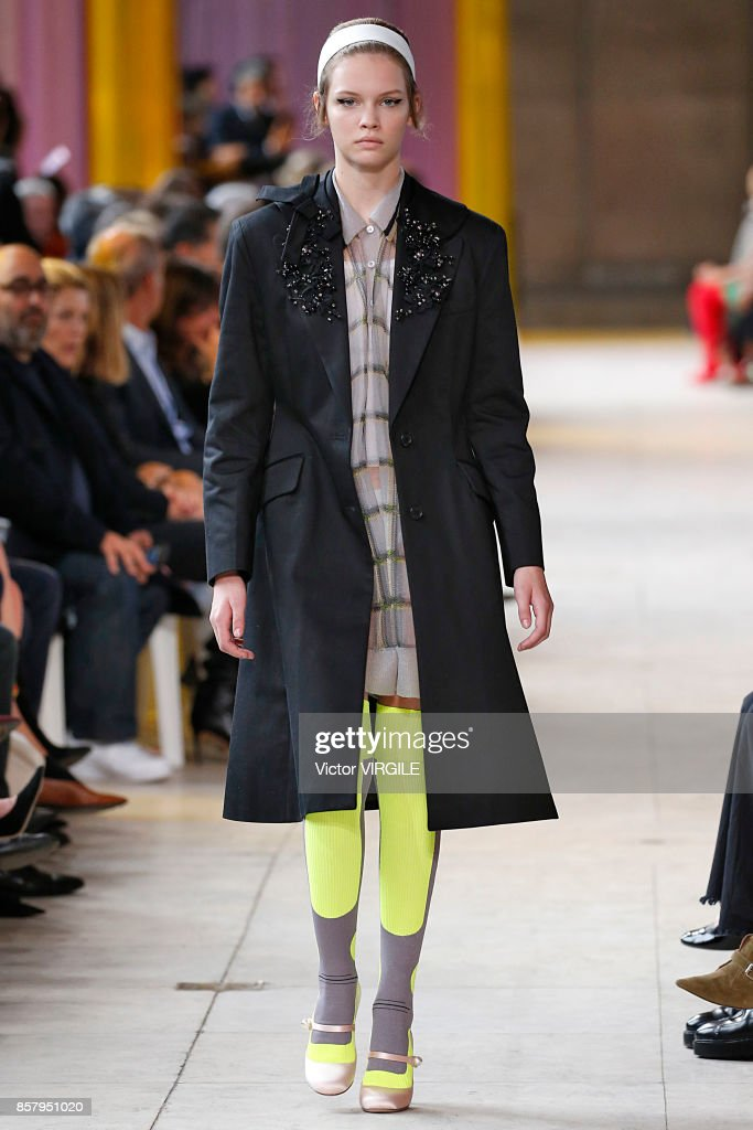 A model walks the runway during the Miu Miu Ready to Wear Spring/Summer 2018 fashion show as part of the Paris Fashion Week Womenswear Spring/Summer 2018 on October 3, 2017 in Paris, France.