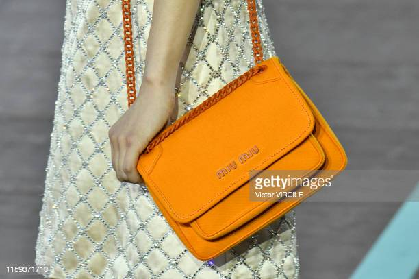 Model walks the runway during the MIU MIU resort Jockey Club Spring/Summer 2020 fashion show at the Hippodrome d'Auteuil on June 29, 2019 in Paris,...
